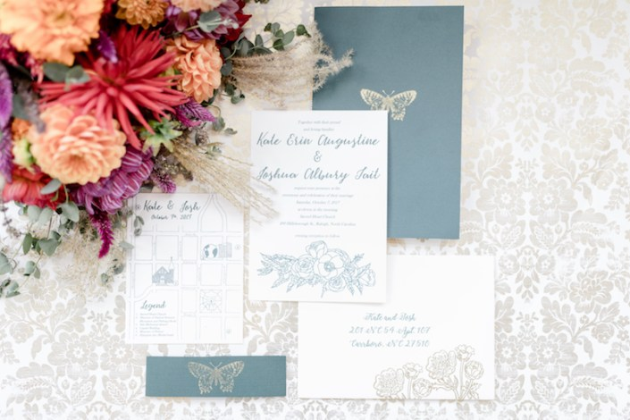 Invitation suite photographed with flowers