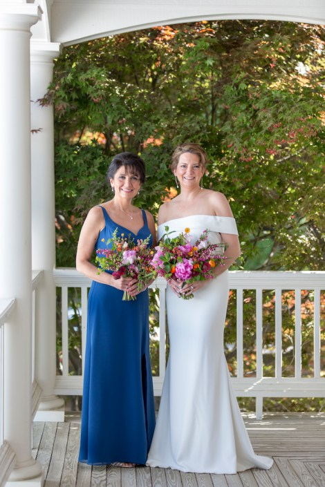 bride with her maid and their bouquets in a blue and spring colors bouquet