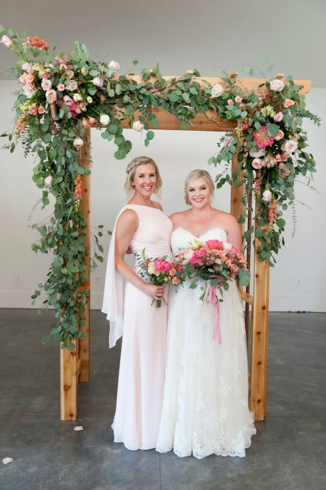 bride-maid-of-honor-ceremony-arch-spring-wedding