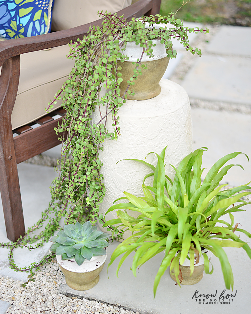Colorful mix and match outdoor patio pieces planters