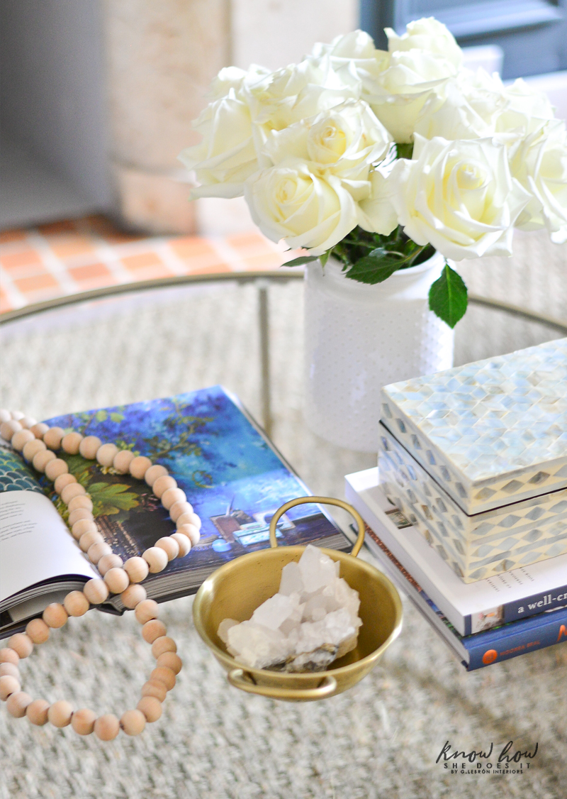 An open book with blue images to accompany the entire room's look.
