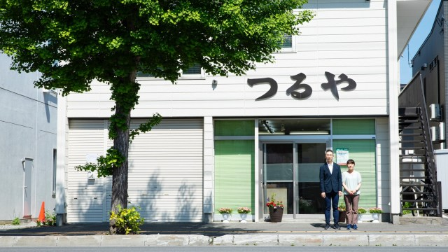 Yuuki and his wife Hanae in front of their store