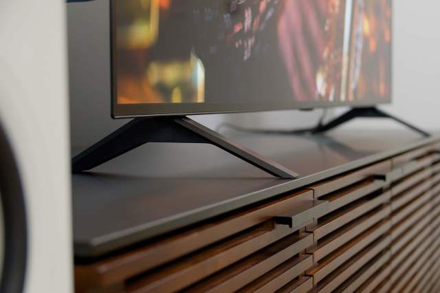 Close up image of the LG A1 OLED 4K HDR TV's stand.