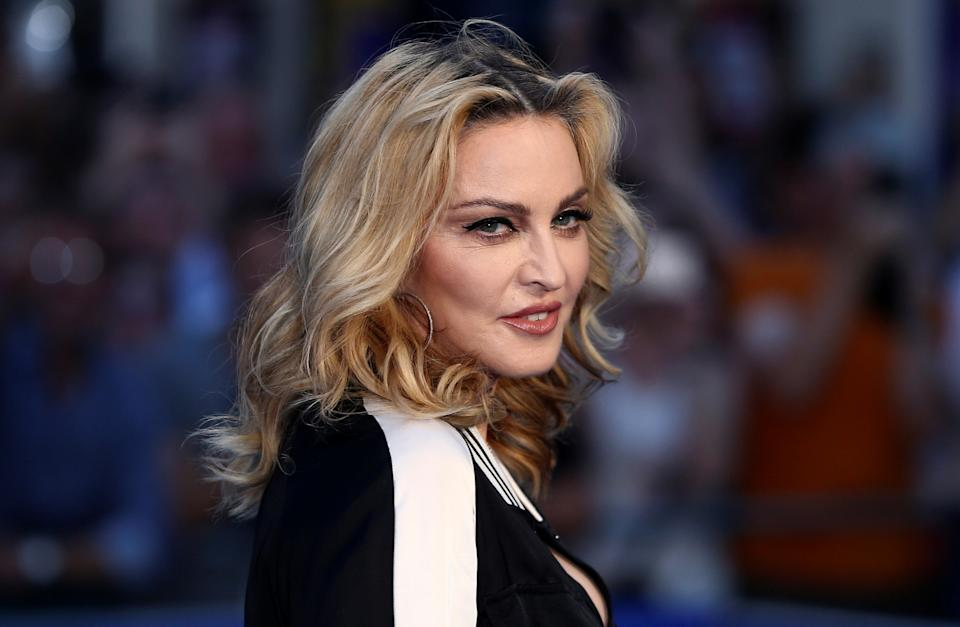 """I Rise"" Song Lyrics by ""Madonna"""
