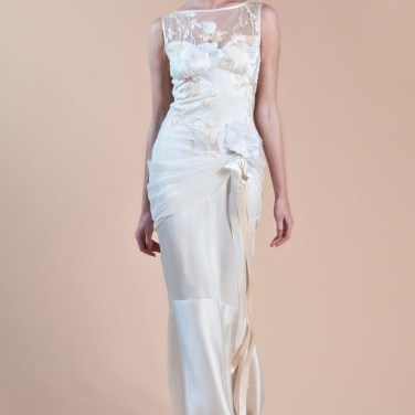 WILLOW 2017 COLLECTION Fluid and sleek are the best way to describe the WILLOW wedding dress. A beautiful floral embroidered motif cradles your top from the bateau neckline and sheer illusion back while a graceful silk charmeuse sheath flows to the floor. Silk ribbons and flowers are the final touches that complete this lovely picture. Willow is available as shown Gold with pearl silk under-layer