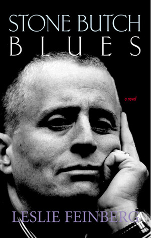"A cover of ""Stone Butch Blues"" by Leslie Feinberg, featuring a black and white portrait of Feinberg with their left hand on the side of their face, looking thoughtful."