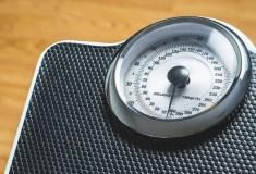 Übergewicht Waage