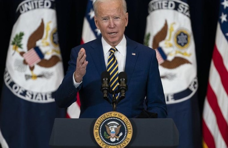 Biden strikes tough tone on Russia in diplomatic push