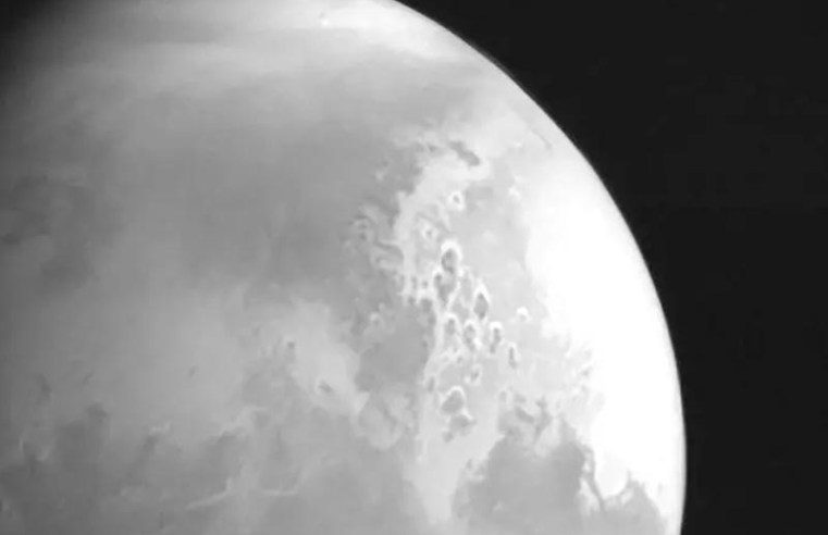 China's space probe sends back first image of Mars ahead of this year's landing