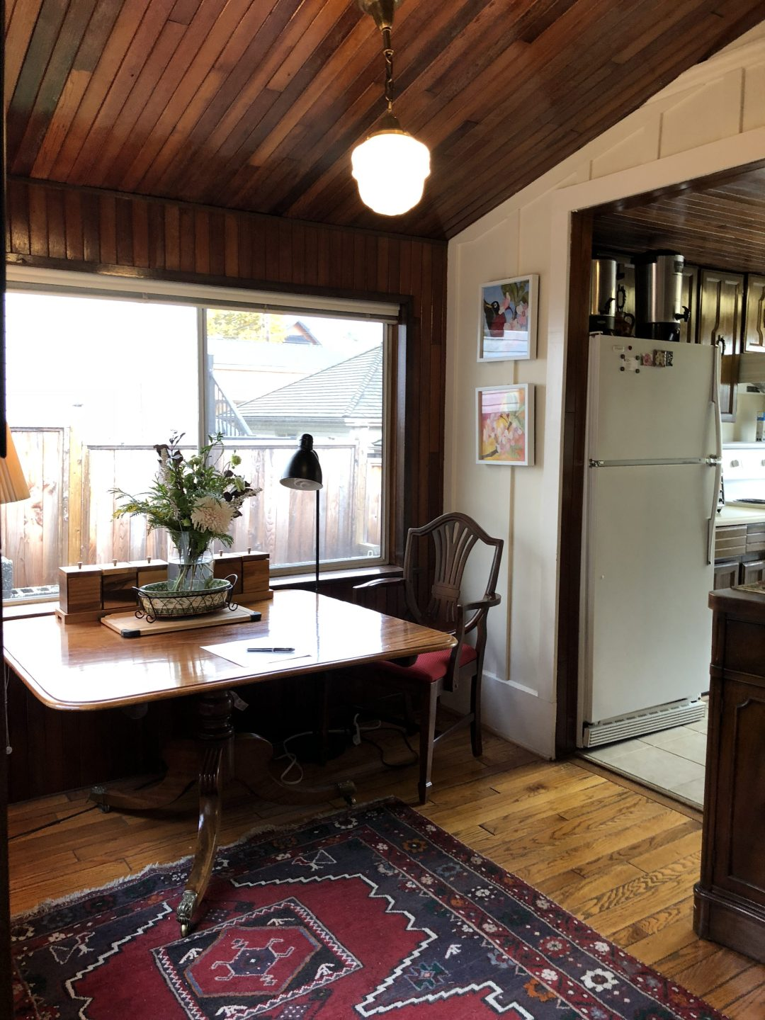 Dining area with view of galley kitchen