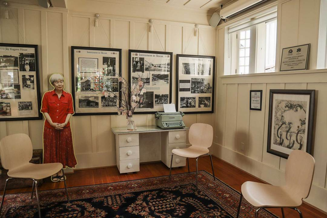 In the living room, you can see and touch the desk at which Joy Kogawa wrote her novel Obasan.