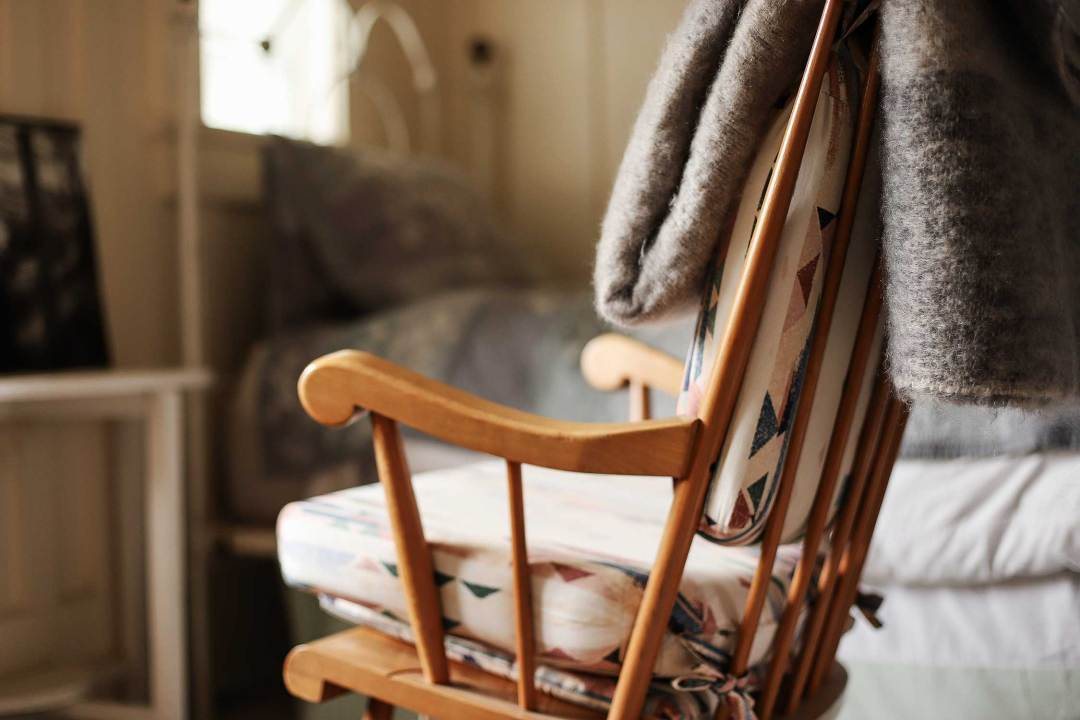 A rocking chair in the writing room at Historic Joy Kogawa House.