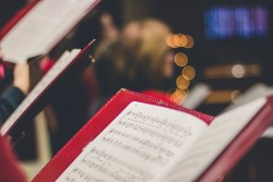 view of music in song book with out of focus background