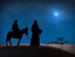 Joseph leading Mary riding on a donkey walking toward the star.