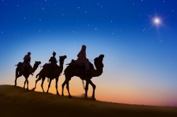 The Three Wise Men riding camels toward the star.