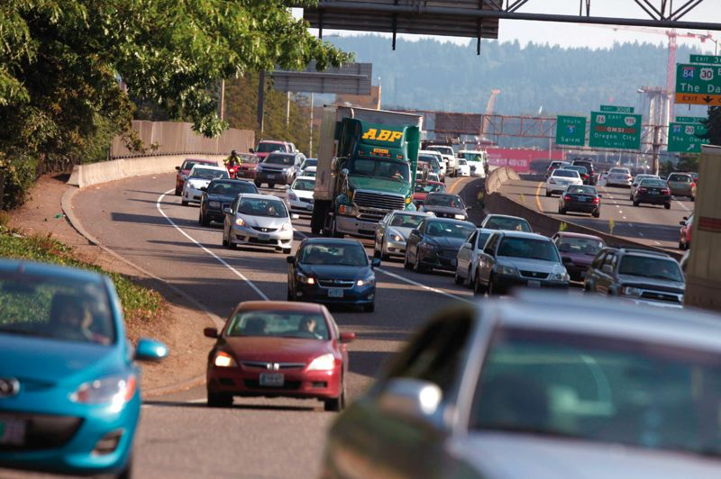A recent ODOT report attributed hours of delays to I-5 bottlenecks, but critics say new lanes draw new traffic. generic congestion portland fre_513872