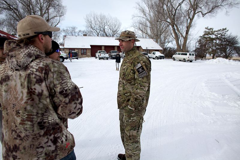 Blain Cooper, 36, and fellow protesters stand in the seized Malheur Nation Refuge complex about 30 miles from Burns. The group wants federal la_260873