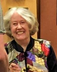 Harriet McDougal w'płaszczu barda