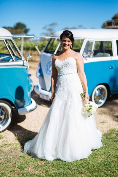 Bride on her wedding day in front of Kombi Cruise 1960s Vintage Volkswagen Kombi Vans on her Wedding Day