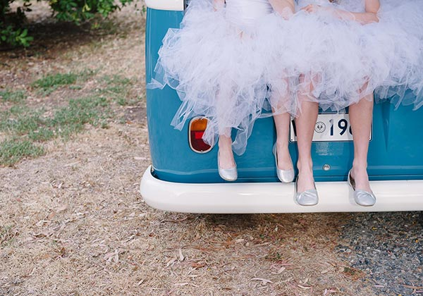 Two girls, flowergirls sitting in the back of Volkswagen Kombi Van for Wedding Day Hire in Adelaide