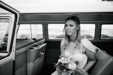 Black & White Shot of Bride in Vintage Volkswagen Kombi Van on Wedding Day