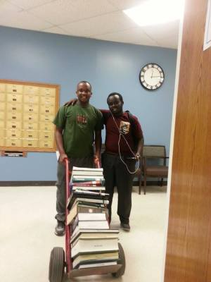 Founder and CEO of African Tutor Humphrey Musila with his friend Walter Kosgei after receiving a donation of books from students at Park University