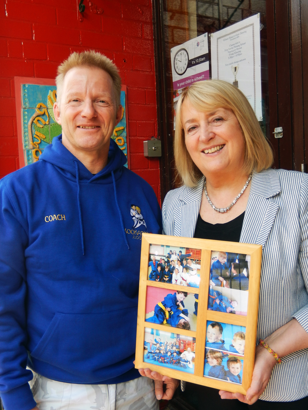 Jonathan presents Mrs MacManus with a photo collage