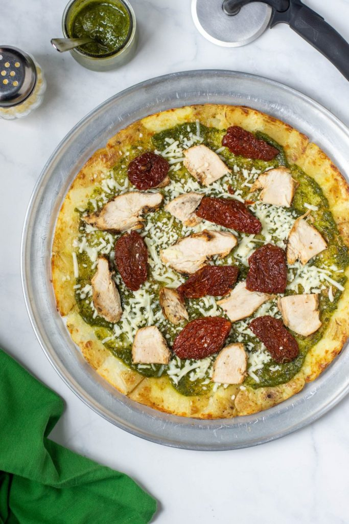 BABY POTATO PIZZA CRUST with chicken, pesto, and sun-dried tomatoes