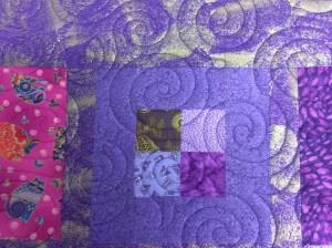 Swirls purple quilt