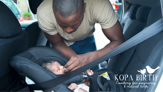 car seat safety tips - dad putting newborn in carseat