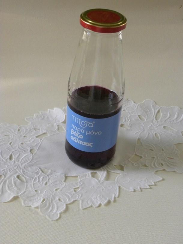 Μπουκάλι με συρόπι ροδιού εικόνα