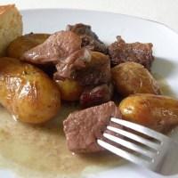 Afelia (Marinated Pork in red wine)