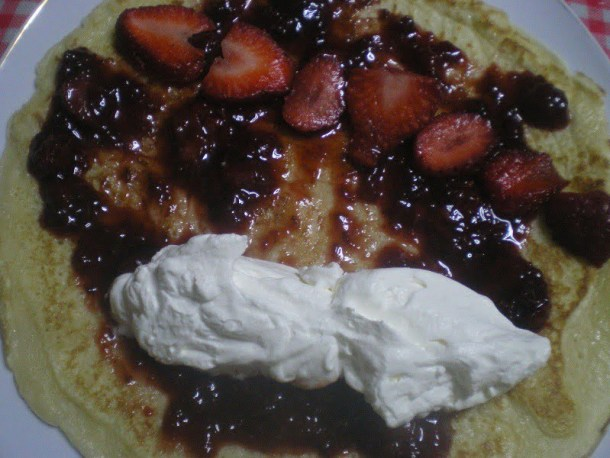 Crepe with strawberries and whipped cream image