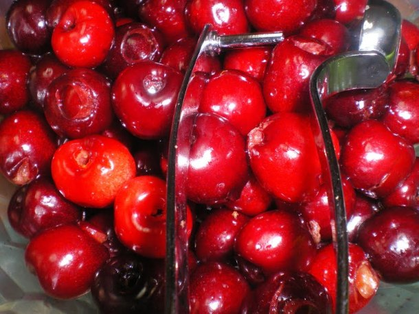 cherries with a cherry pitter image