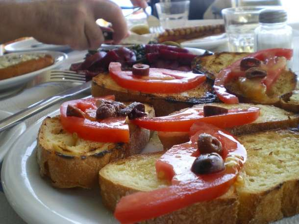 Greek bruschetta with tomato and olives image