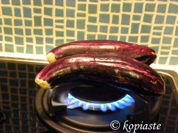 Charring eggplants