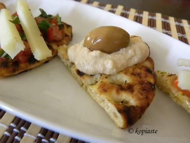Pita chips with taramosalata and green olives