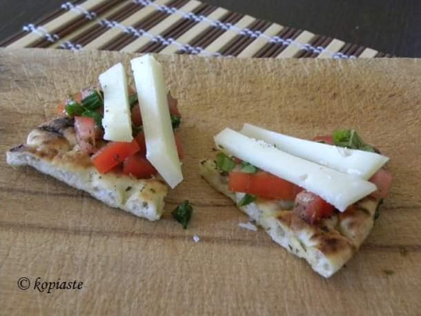 Pita chips with tomato, basil and graviera