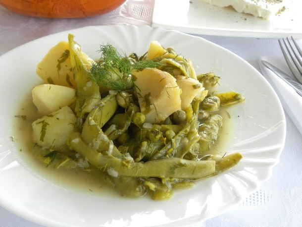 Fava beans koukia with potatoes artichokes and peas image