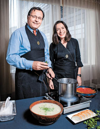 British Ambassador Charles Hay, left, and his wife, Pascale Sutherland, serve up freshly made cullen skink at the Grand InterContinental Seoul Parnas in southern Seoul. [PARK SANG-MOON]