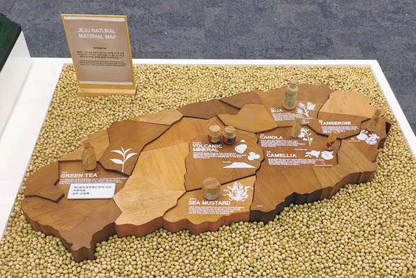 A miniature of Jeju Island shows a couple of villages growing AmorePacific's cosmetics ingredients indigenous to island that will be developed into tourist attractions.