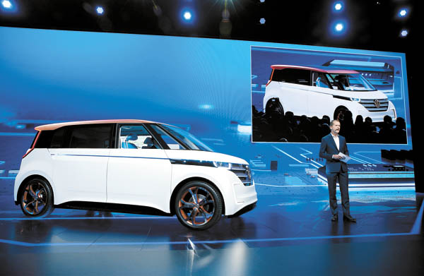 Volkswagen CEO Herbert Diess unveils the BUDD-e electric car during a keynote address at the CES. [AP]