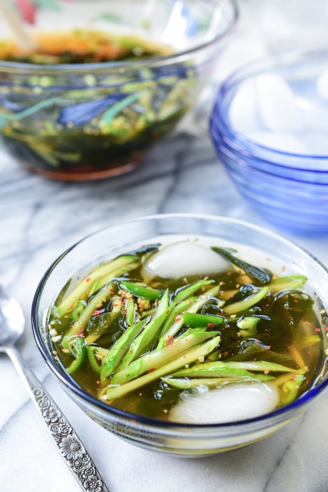 Korean cold cucumber soup in a glass bowl