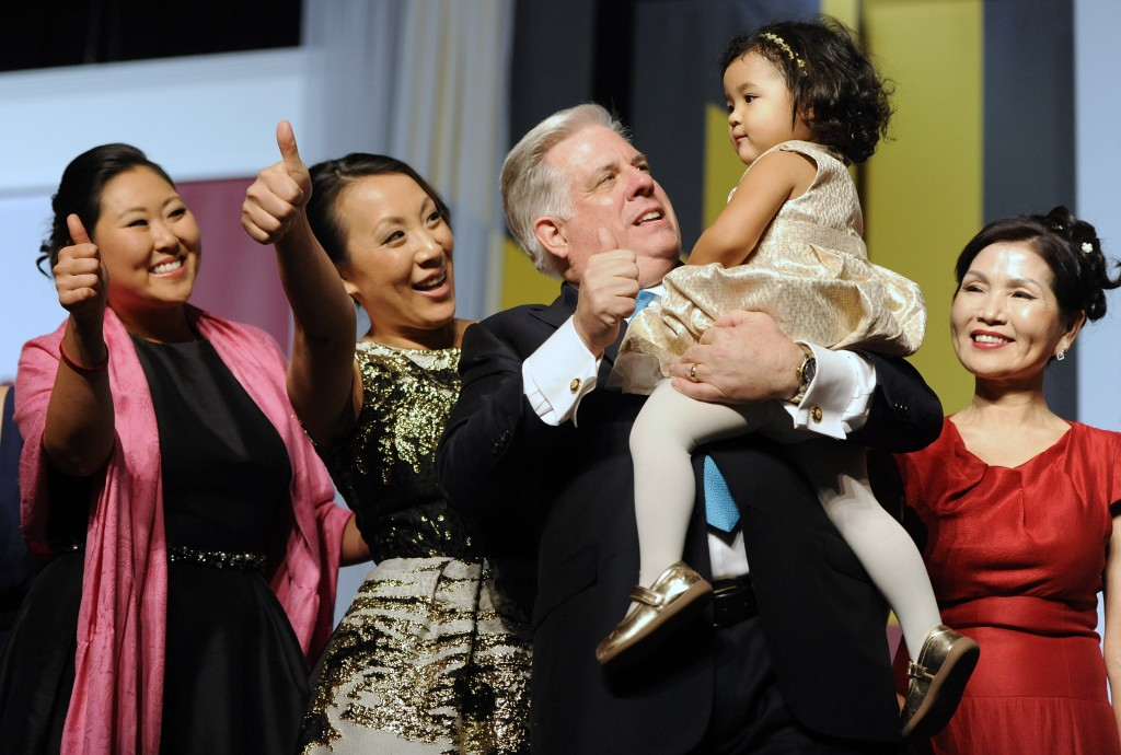 Maryland Gov. Larry Hogan, center, smiles with his daughter Jaymie Sterling, left, daughter Kim Velez, second from left, granddaughter Daniella Velez, 2, and wife Yumi, right, during his inaugural gala in Baltimore, Wednesday, Jan. 21, 2015. Hogan is the 62nd governor of Maryland. (AP Photo/Steve Ruark)