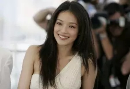 """CANNES, FRANCE - MAY 20:  Actress Shu Qi attends a photocall promoting the film """"Three Times"""" at the Palais during the 58th International Cannes Film Festival May 20, 2005 in Cannes, France.  (Photo by MJ Kim/Getty Images)"""
