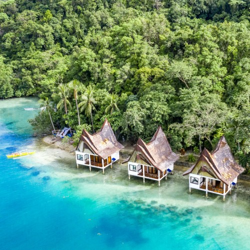 Over-water bungalows at Club Tara in Bucas Grande