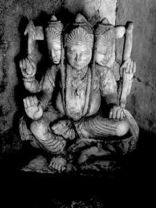 mystic poem - black and white stone three headed hindu god