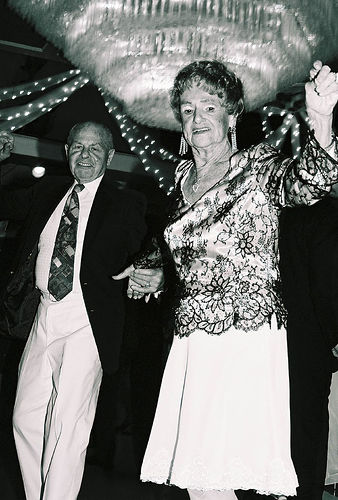 elderly laughing black and white photo