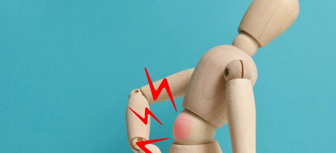 tiny mannequin with inflamed red center to symbolize back pain