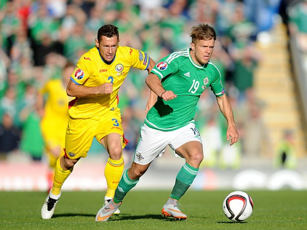 Soccer - UEFA European Championship Qualifying - Group F - Northern Ireland v Romania - Windsor Park. Northern Ireland's Jamie Ward and Romania's Laszlo Sepsi (left) battle for the ball during the UEFA European Championship Qualifying game at Windsor Park, Belfast. Picture date: Saturday June 13, 2015. See PA story SOCCER Northern Ireland. Photo credit should read: Martin Rickett/PA Wire URN:23288244